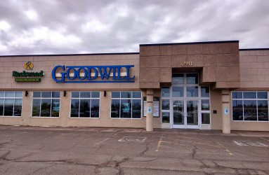 A new sign is up at the future location of the Superior Goodwill store.